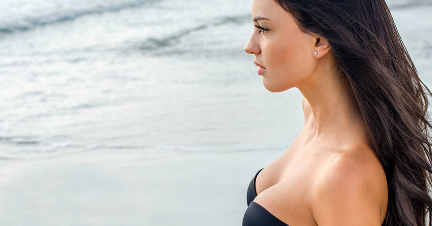 A small incision is made either under the breast or around the areola, and an implant is inserted under the breast tissue or under the breast tissue and the underlying muscle.